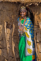 Young Masai Girl Standing in Hut's Entrance