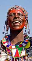 Chanting Masai Woman Displaying Beadwork
